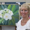 Lyn Sparrow stands in front of her work